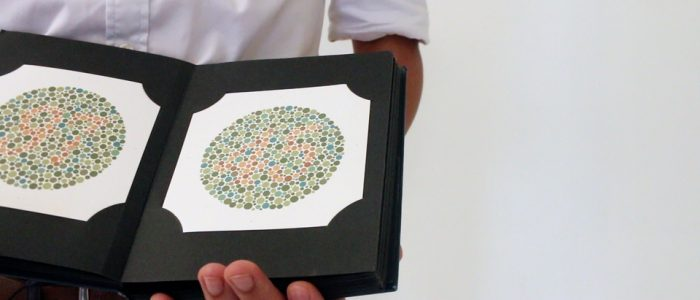 Ask the patient to read the numbers on the Ishihara plates